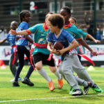 LONDON, ENGLAND - JULY 15:  Children from the Fight 4 Change Foundation and local schools take part in the NFL Launch of the Play 60 scheme at the Black Prince Community Hub on July 15, 2015 in London, England.  (Photo by Dan Mullan/Getty Images)